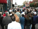 The crowd wraps around the corner of the new museum building as Mayor Womack speaks.