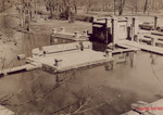 This picture showing the stage and dressing room facilities is taken from the apitheatre from an area that is not too far from shore when water is at normal level. The steps behind the stage is the docking area for the gondolas that carried visitors from the hotel to the ampitheatre.  Copyright 1958 - 2006
