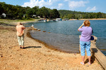 Early August 2005 found the lake dropping enough that the seating area was visible. It attracted this group of Kansans who had to check it out.