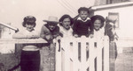 According to Loretta's hat and everyone's clothing, this is probably right after the Kansas State Fair in 1945, right after World War II ended. It shows Loretta, Jerry, Maye, Jackie, Loulu Maye and her colt of the month.  Photo Copyrighted