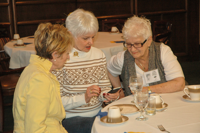 Jan (Hall) Dillon, Janet (Perry) Schreck, and Jane (Jones) Zmora compare notes. 