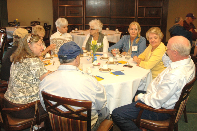 Emmett Allen, Connie (Westerman) Albright, Janet (Perry) Schreck, Jane (Jones) Zmora, Judy Allen, Mary Lou & Jerry Creech, Tisha and Larry Meier chat while waiting to get breakfast.