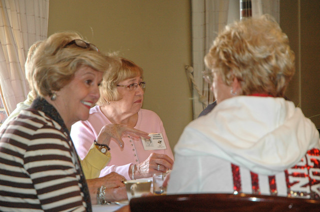 Sharon (Stremmel) Utz, Carlee (Penner) Woodson, and Sherry (Coffman) Solomon chat after breakfast.