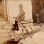 "John tries out his new ""high wheeler"" trike most likely right after Christmas in 1917 in the front yard of the family home in Denver. Those tall wheels shoud have come in handy in that heavy show.