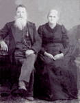 William Edward and Ellen �Eleanor� (Baird) Hickey, parents of Ella May (Hickey) Dickerson, are shown in a formal portrait.